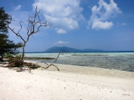 """Welcome to Cemara Kecil Island. Leave nothing but footsteps, take nothing but memories."" – Says a wooden sign at the desert island close to Karimunjava."