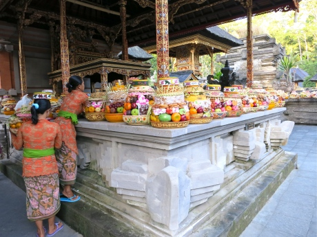 Women arrange the Puja, Hindu offerings to the deity, at the Tirta Empul temple.