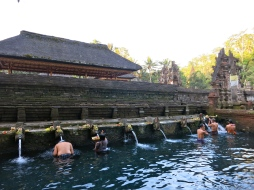 Believers take a bath in the holy and purifying spring water of Pura Tirta Empul, a 10th-century, Hindu water temple.